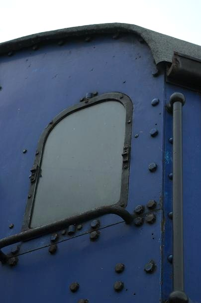 The broken windows in the cab were removed, their glass replaced and then refitted.